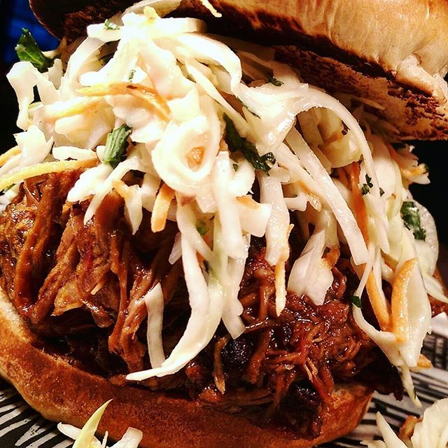 14 hour, oak smoked pulled pork topped with buttermilk slaw. Both filled inside a brioche bun. Come at us. - 2016-02-10 18:30:33