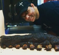 Pitmaster Benjamin in Manchester showing off some fresh smoked huge beef long ribs.  Whose order is this?  #pitmaster #beefribs #foodporn #instafood #lowandslow