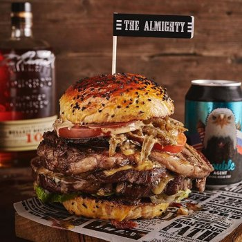The Almighty, the mother of Father's Day treats.  Limited availability – online bookings at the bio link. *28 day dry-aged rib eye, bathed in @bulleitwhiskey 10 for a further 3 weeks. *Sandwiched between a squishy BEERger brioche bun made with Imperial Russian Stout. *Cured bacon & bourbon jam *Yorkshire Blue and Cheddar cheese, Portobello mushroom, caramelised onions and Dirty sauce.  Comes with: *Halloumi fries and cheeseburger truffle dipper *Can of Legitimate Industries Double Agent Imperial Russian Stout (10.4%) *jar of barrel-aged Old Fashioned BBQ sauce  Bookings live in the bio link