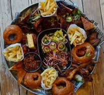 How to upgrade your Saturday: Grab your best pals, order a Feast, eat yourself into a meat coma. 🐷